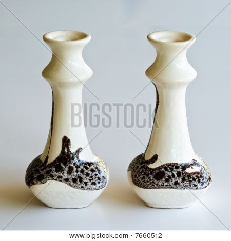 Pair Of Ceramic Candlesticks In Retro Style On Light Grey Background