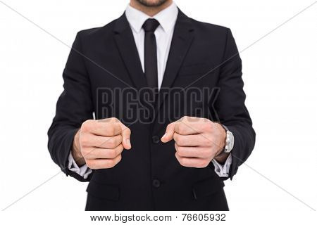 Elegant businessman in suit clenching his fists on white background