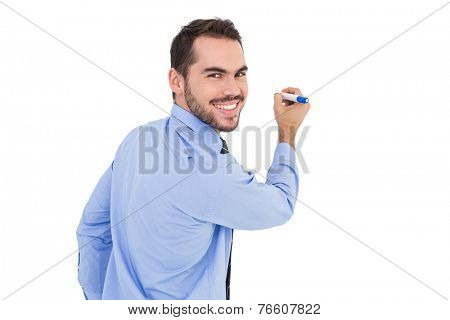 Happy businessman in shirt writing with marker on white background
