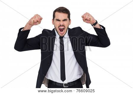 Furious businessman tensing arms muscle on white background
