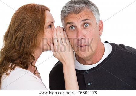 Woman telling secret to her partner on white background