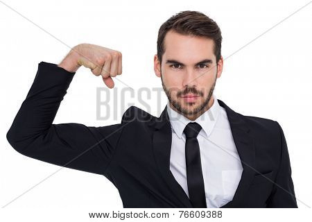 Businessman tensing arm muscle and looking at camera on white background
