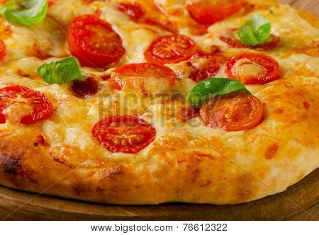 Homemade  Pizza With Cheese, Basil And Tomatoes