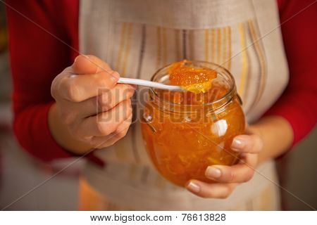 Closeup On Young Housewife Holding Homemade Orange Jam