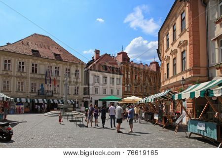 Ljubljana, Slovenia - Circa July 2014: Tourists Wander Through The Old Town In Ljubljana, Slovenia.