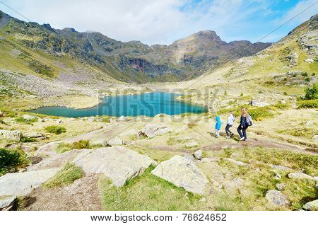 Three Siblings Hiking To Estany Primer In Tristaina, Andorra