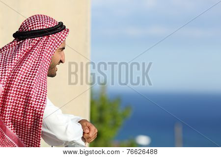 Arab Saudi Man Looking The Sea From A Balcony Of An Hotel