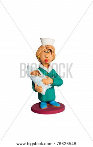 Doctor figurine with infant
