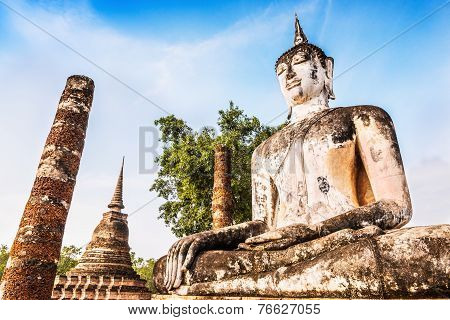 Ancient buddha Statue at Wat Mahathat in Sukhothai Historical Park Thailand.