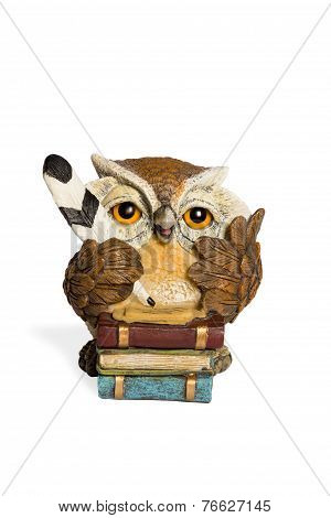 Statuette beige owl with feather and books