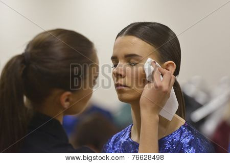 NOVOSIBIRSK, RUSSIA - NOVEMBER 15, 2014: Model during makeup application before the fashion parade during Novosibirsk Fashion Week. The event was held under the motto High Fashion & High Classics