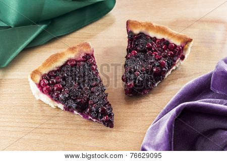 Two pieces of cow berry pie.