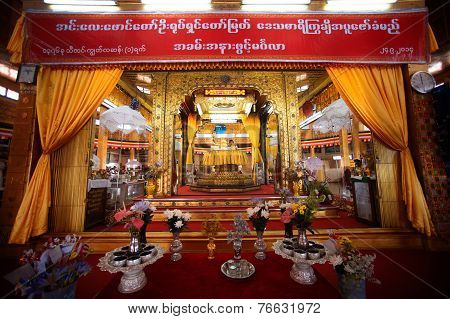 Five Small Golden Buddha Images In The Centre Shrine In The Main Hall In The Temple.