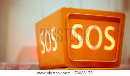 orange sos sign, closeup view