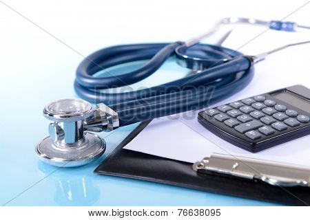 Stethoscope on light blue background