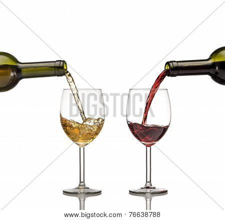 Red And White Wine Being Poured Into Wine Glass On White Background