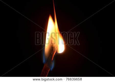 match fire isolated on black background