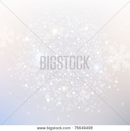 Light silver abstract Christmas background with blurred white snowflakes