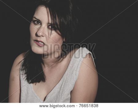 vulnerability woman concept of psychological abuse, beautiful young brunette