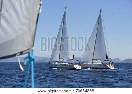 Sailing boats during a sea race. Yacht. Sailing. Yachting. Luxury Lifestyle.