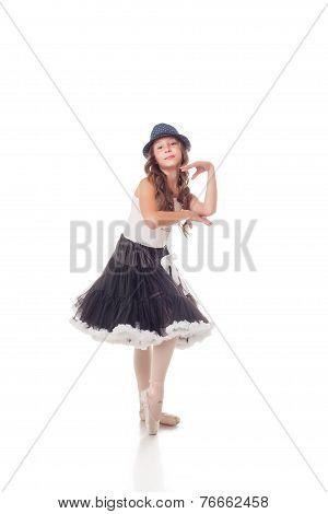 Funny young ballerina posing at camera