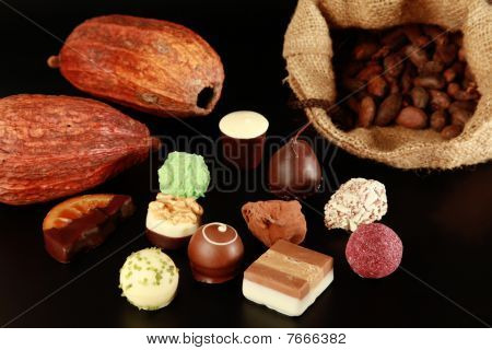 Chocolates, cocoa pods and beans