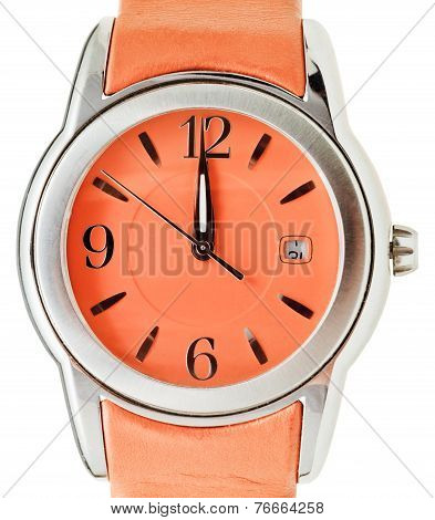 One Minute To Twelve O'clock On Orange Wristwatch