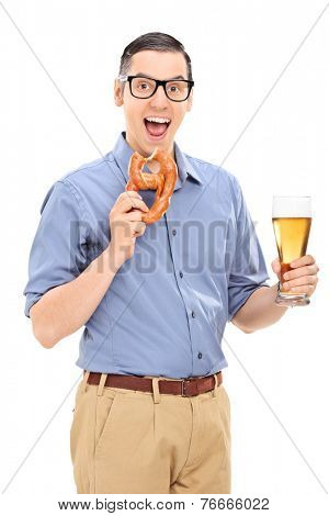 Vertical shot of a man eating a pretzel and drinking beer isolated on white background