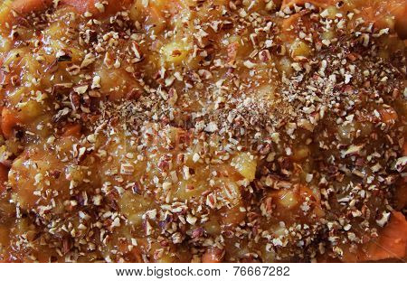traditional sweet potato casserole topped with chopped walnuts and brown sugar.  side dish for a Thanksgiving or Christmas holiday dinner.