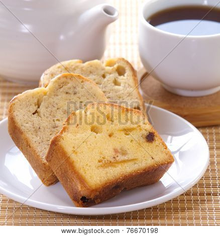Sponge fruit cake and cup of tea