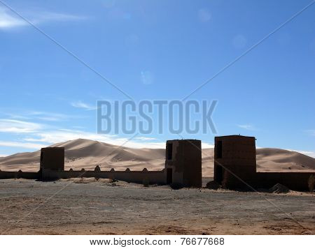 Gatehouses And Wall Before Sahara Dunes
