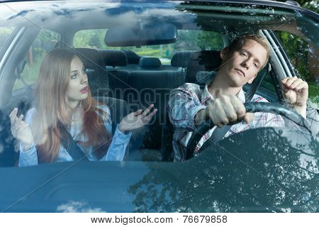 Young Couple Arguing In Car