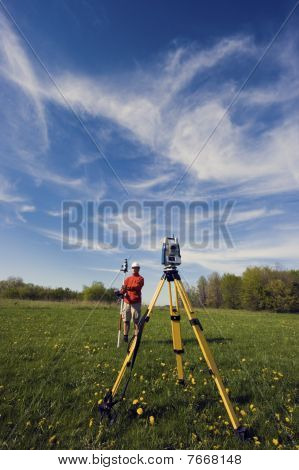 Land Surveyor Working With Robotic Station