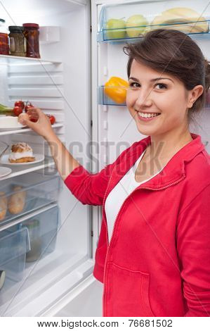 Girl Standing By The Fridge
