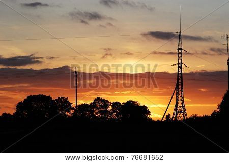 Silhouette Electricity Pole In Sunset