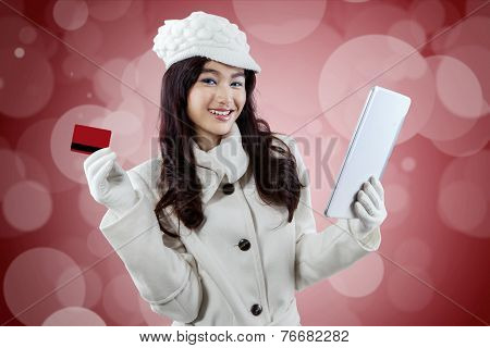 Attractive Buyer With Tablet And Credit Card