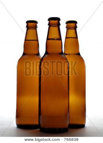 Three beer bottles other white background