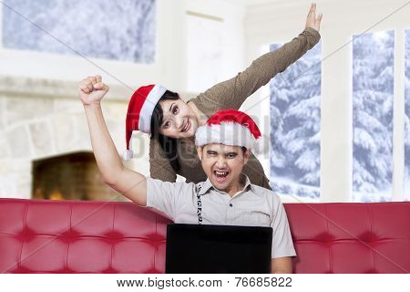 Couple Prepare Christmas By Shopping Online