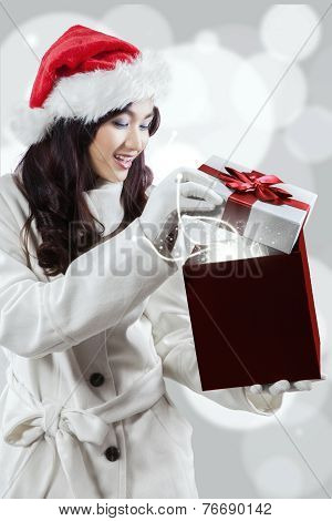 Young Woman Opens A Gift Box