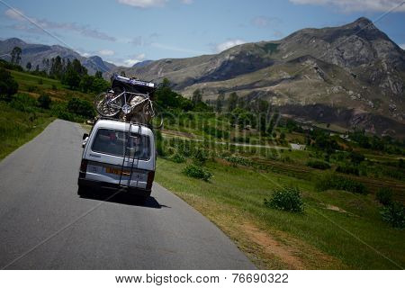 MADAGASCAR- DECEMBER 23, 2013. Overloaded bus moves in the mountains.