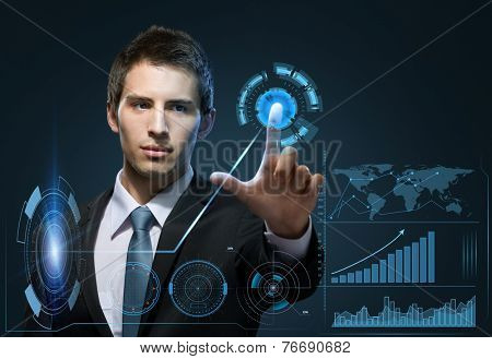 Half-length portrait of manager touching virtual screen. Technology concept