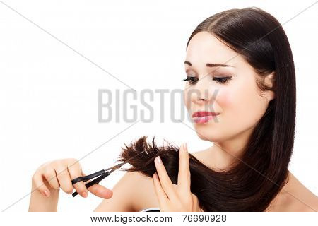 woman is not happy with her fragile hair, white background, copyspace