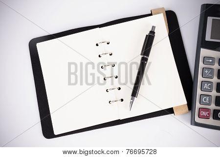 Notebook, Ballpen And Calculator