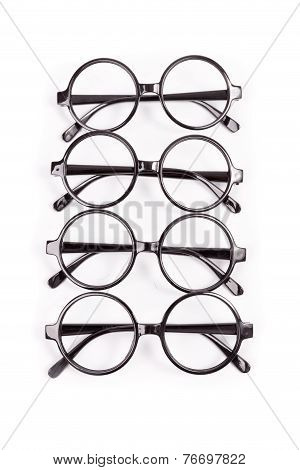 Stack Of Black Glasses Isolated On White