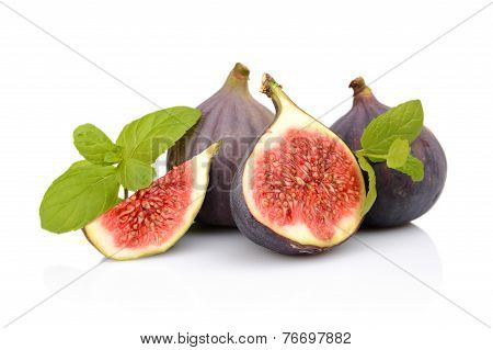 Four Sliced Figs Isolated With Mint On White Background