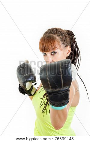 Girl In Rage Wearing Boxing Gloves Ready To Fight And Standing In Combat Position