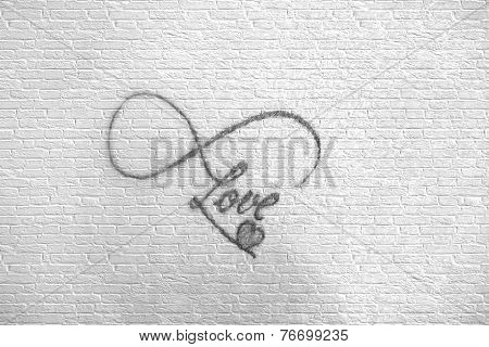Photo Of Abstract Tattoo On Brick Wall That Says Love With Smal Gray Heart