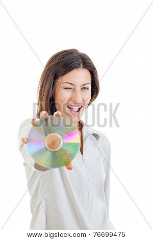 Smiling Woman Holding Up Compact Disc Or Cd  And Looking At Camera