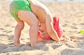 pic of upside  - baby standing upside down on the beach - JPG