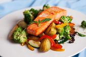 stock photo of gourmet food  - salmon fillet with vegetables and basil on a plate - JPG